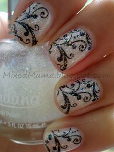 Nail Art....Nude Vintage Design. 3 coats of Sally Hansen Diamond Strength in Royal Icing. Then using the New 2012 Bundle Monsters Stamping Plates use image from BM-314 with MASH's Nail Art Polish in Black.