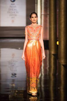 Orange sari pattern dress with cinched waist by JJ Valaya at India Bridal Fashion Week.