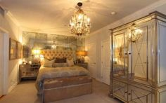 Kim Kardashian's old Hollywood glam bedroom...mirrored wall behind bed for E