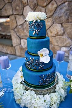 love the deep blue cake, unexpected colour, the different details on the layers, and the flowers on top(cake D'Lish Catering, photo by annie x photographie)