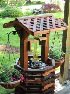 Solar Energy Products and DIY in the Garden Lecture: Image is a Wishing Well Fountain with Planters and Solar Lights