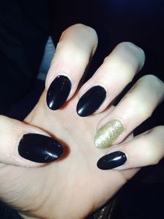 Love love love black and gold almond nails