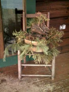Prim Christmas...old chair with wooden bucket...stuffed with pine & old skates.