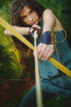 Archery World Cup in Croatia V, Model: Sara Renar, photo by: Marina Filipovic Marinshe. Inspiration! Hot archery chick in tights rather than pants. Oh hey, note the finger protection glove on one hand and bracer on the other, with a traditional long bow. Hmmmm