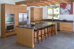 This one-of-a-kind home is truly unforgettable and incredible! The modern kitchen is a show-stopper!