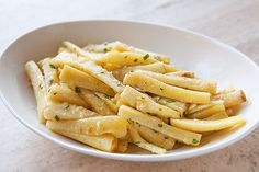 Parsnips roasted in butter and stock with parsley, chives, garlic, and a touch of horseradish.