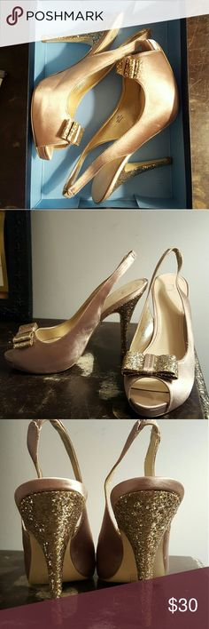 🌠🌠PRICE DROP! Champagne Disney Heels Sparkley gold/champagne disney heels! I only wore them once, so they are in great condition. Theres just one small spot on one of the straps, which is barely noticeable (last pic.)They're great for prom or other formal events! I can ship them in the box if you'd like :) Disney Shoes Heels