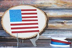 Use glitter tape and a slice of wood to make this sparkly flag.