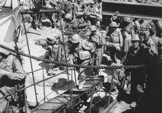 Official U.S. Army photograph, taken a Pozzuoli near Naples in August 1944, that happened to capture Private First Class Steve Weiss boarding a British landing craft. He is climbing the gangplank on the right-hand side of the photograph.""