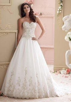 Sleeveless tulle, organza and hand-beaded embroidered lace ball gown with double lace shoulder straps, sweetheart neckline, drop waist, chapel length train.