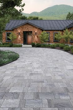 With its chiseled and sculpted texture, the Eva paver brings a new perspective to a traditional-looking driveway! Modern Driveway, Driveway Design, Driveway Landscaping, Modern Landscaping, Landscaping Ideas, Driveway Ideas, Driveway Gate, Paving Texture, Cobblestone Driveway