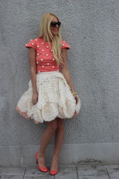 Coral top embellished with large pearls, cream ruffled tier petticoat skirt, coral pumps