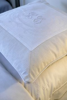 Monogramed linen-possible idea for using a smaller piece or cloth antique and insetting within larger sham, etc. Border of other fabric or attaching to surface of a whole.