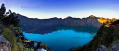 Mount Rinjani Crater Lake during the Sunrise, Lombok, Indonesia. Gunung Baru, seen at the centre of the lake is an active volcano. Taken from the Seneru crater Rim during the third day of the trek. The peak at the left side is the summit (3726m). Camping tents can be seen on the right. By Manu Ignatius via 500px