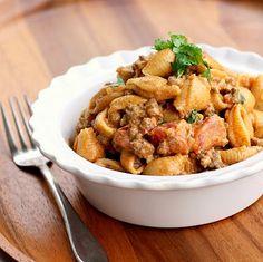 Taco Pasta- Ground beef, pasta shells, small chopped onion, garlic, 14oz diced tomatoes w/green chilis drained, taco seasoning, 3oz cream cheese, 1/2 c sour cream, cilantro, salt & pepper