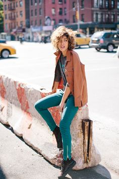 colored jeans with graphic top and jacket
