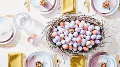 Learn how to decorate Easter eggs using two tricks! Take a combination of brown and white eggs, and dye half of them in faint lavender or bronze; then spray contrasting colors on all of the tops.