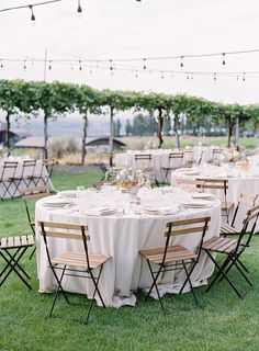 real wedding photo outdoor summer wedding columbia river gorge view washington callista and company outdoor reception wood folding chairs vineyard view bistro