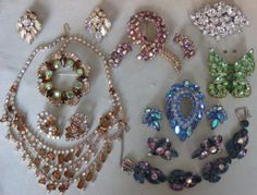 My grandma bought me a shoebox full of antique rhinestone jewelry to play with. Sure wish I still had it...