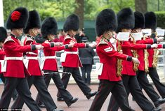 Rousing performance: Soldiers from the Queen's Guard march down the Mall outside Buckingham Palace as part of a dress rehearsal