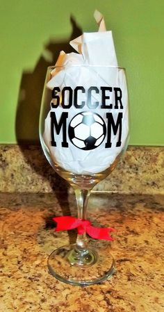 A personal favorite from my Etsy shop https://www.etsy.com/listing/223512186/soccer-mom-wine-glass-w-decorative-vinyl