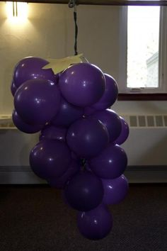 DIY Giant bunch of grapes made from balloons for visualizing the grapes the 12 spies brought back from Canaan. More pictures and tutorial here: http://kidfrugal.blogspot.com/2014/11/the-grapes-of-canaan.html. Good for Promised Land VBS 2014.