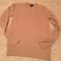 J.Crew Tan Cashmere V-Neck Sweater! J.Crew Tan Cashmere V-Neck Sweater! Size: small! Only worn once, in PERFECT condition!! 55% wool, 30% nylon and 15% cashmere!! Dry Clean ONLY!!! J. Crew Sweaters V-Necks