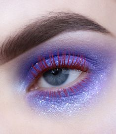 An easy makeup tutorial to achieve an urban mermaid look using turquoise and purple eyeshadow.