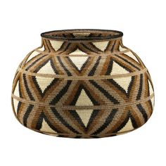 """Geometric in brown, black, and natural tones sits perfectly flat on a table or shelf  - Chunga palm (Astrocaryum standleyanum) & Naguala (Cardulovica palmata) fibers, vegetal dyes   - 6"""" H x 8.75"""" W, silk-stitch technique   - Nine months in construction. $1,800"""