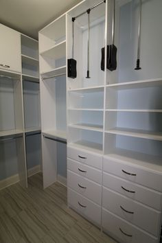 To maximize the high ceilings, this homeowner opted for pull down closet rods.
