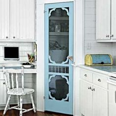 A lot of times, you have a corner in your kitchen that makes for awkward cabinetry or unusable space. An easy fix is to create a corner pantry. If you use a vintage screen door (or a full glass door) at the opening, it enables you to see in and keep the space looking large, because you haven't visually cut off the corner with a solid door.