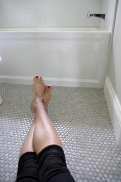 """Mobe Pearl grout, penny tile....1/8 grout line in the shower, 10x19"""" shower tile.  """"Grout Shield"""" sealer (acrylic resin colorseal with a modified urethane sealing agent)"""