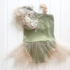 Photo prop girl romper made from stretchy green fabric , unique look , tulle ruffles and beautiful embroidery on one shoulder and lace bracelet on the other one