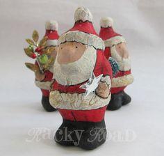 Handpainted Santa Figurine with Shiny Star