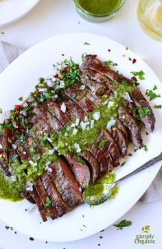 Dress up grilled flank steak with an easy summer chimichurri sauce recipe featuring fresh herbs and vibrant organic spices. | Simply Organic