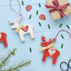 Nordic Wooden Reindeer Ornaments with painted stitch detail #christmascraft