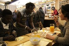 Kitchen on the run, locals and refugees eating together