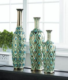 #Decorative Peacock Jewel Multi-Color #Stoneware Flower Vase Set or Single Vase  Wow your guests with this dramatic peacock-inspired #vase set that will draw their attention and admiration. The beautiful #peacock design is highlighted by shimmering gold touches and turquoise jewels that sparkle and shine ensuring they're ready to strut their style on your mantel, table or shelf.