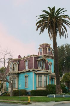 Blue and red Victorian home