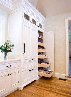 Love the colours of the doors, bench, knobs and handles, plus the clever pantry.  Plus the cute little cupboards on top of the pantry.