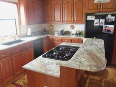 netuno bordeaux granite countertops - Google Search