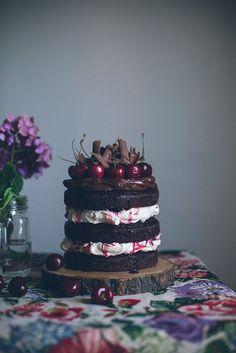 chocolate cake * thick meringue*repeat*thick favorite chocolate frosting*cherries*chocolate shavings