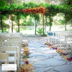 We gave an asymmetrical whimsical touch to this wedding ceremony by grouping all of the brightly colored flowers in an overgrown, natural garden inspired cluster. Grapewood, moss and james story orchids accent the aisle. Location Nestldown #rusticinspired
