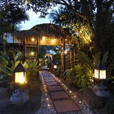 Pathway, contemporary, lighted, flagstone / pavers & pebbles, lanterns, palms, lush tropical foliage.