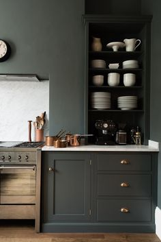 Kitchen organizing ideas for your home. Love the color and design of the cabinet