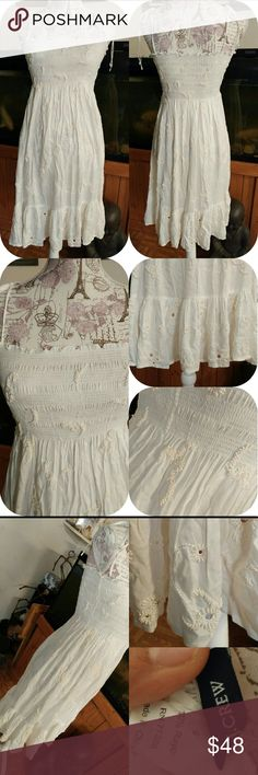 J.CREW EMBELLISHED LITTLE WHITE DRESS Tube top like top with ties spaghetti straps. Embellishments are gorgeously placed through out the dress. Tag size Small. Stretchy to fit me at medium. J. Crew Dresses