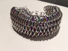 A personal favorite from my Etsy shop https://www.etsy.com/ca/listing/268106206/rainbow-dragonscale-cuff-bracelet