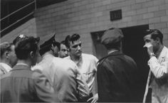 Gene Smith, Bill, Elvis and DJ with the police in the fieldhouse - May 27, 1956 - Dayton, OH