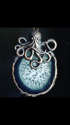 A personal favorite from my Etsy shop https://www.etsy.com/listing/465908753/octopus-and-agate-slice-pendant