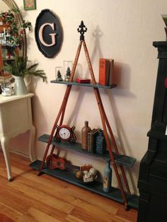 Pyramid Shelf made from a pair of wooden crutches.